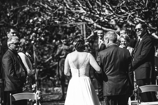 Father of the bride escorting his daughter down the aisle